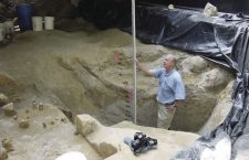 Archaeologist Al Goodyear measures the depth of a dig at the Topper site near Allendale where evidence of human occupation has been found that Goodyear said dates back 50,000 years.
